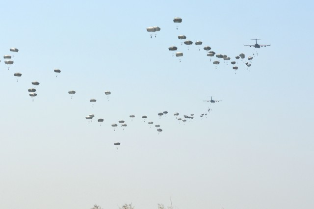 "82nd Airborne Division Paratroopers jump onto Sicily Drop Zone during the All American Week 2016 Airborne Review on Fort Bragg, N.C., May 26. The Airborne Review is the culminating event of All American Week 2016, which is an opportunity for Paratroopers past and present to celebrate being members of the All American Division. This year's All American Week Theme was, ""Tomorrow's Force, Today!"""