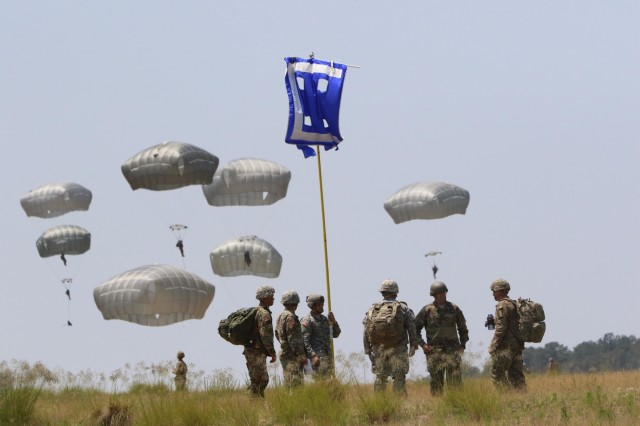 "Paratroopers assigned to the 82nd Airborne Divsion gather at an assembley area at the Aiborne Review during All American Week at Sicily Drop Zone, Fort Bragg, N.C., May 26, 2016. The Airborne Review is the culminating event of All American Week 2016, which is an opportunity for Paratroopers, past and present, to celebrate being memebers of the All American Division. This year's All American Week theme is ""Tomorrow's Force, Today!"""
