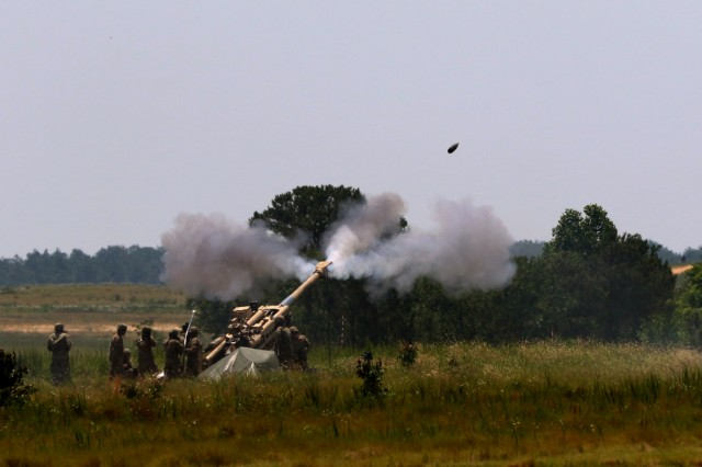 "Paratroopers from the 82nd Airborne Division Artillery Brigade fire their M777 Howitzer during the Airborne Review at Sicily Drop Zone on Fort Bragg, N.C., May 26. The Airborne Review is the culminating event of All American Week 2016 which is an opportunity for Paratroopers past and present to celebrate being members of the All American Division. This year's All American Week theme was, ""Tomorrow's Force, Today!"" (Sgt. 1st Class Alexander Burnett, 82nd Airborne Division PAO)"