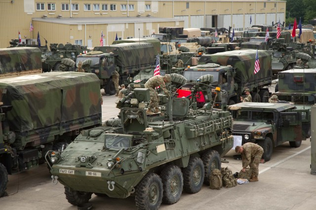VILSECK, Germany -- Soldiers assigned to Task Force Hell, Field Artillery Squadron, 2nd Cavalry Regiment conduct their last pre-movement checks before leaving Rose Barracks, Germany May 27, 2016 to begin their 2400 km road march through six countries including Czech Republic, Poland, Latvia and Lithuania. The convoy will stop in several cities along the route to participate in vehicle static displays and community engagements before ending in Estonia to conduct several training exercises for Saber Strike 16. (Photo by: Staff Sgt. Jennifer Bunn, 2nd Cavalry Regiment Public Affairs)