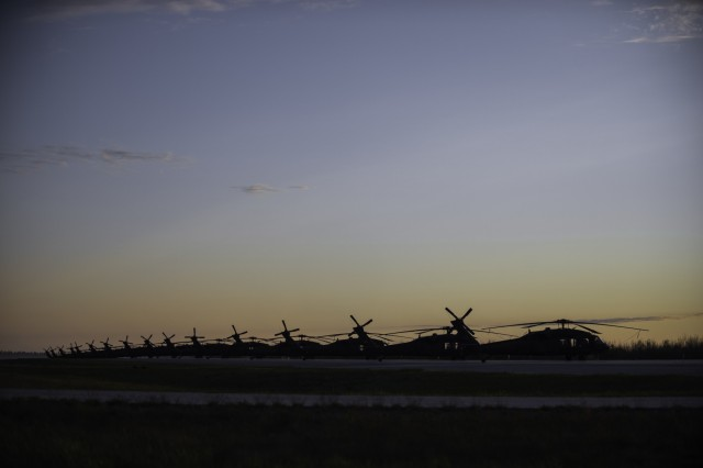 UH-60 Black Hawk helicopters are lined up at Wheeler-Sack Army Airfield here at Fort Drum, May 18, 2016. Black Hawks from the 42nd Combat Aviation Brigade are providing air assault support for C Troop, 2nd Squadron, 101st Cavalry, from Buffalo, as part of an exercise involving more than 3,000 Soldiers from the 27th Infantry Brigade Combat Team.
