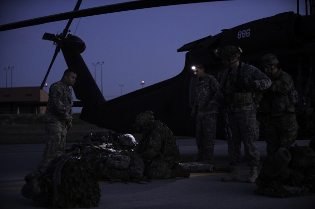 Members of C Troop, 2nd Squadron, 101st Cavalry, of the New York National Guard from Buffalo, receive training on proper loading and offloading techniques prior to their air assault mission here at Fort Drum, May 18, 2016. The UH-60 Black Hawk helicopters of the 42nd Combat Aviation Brigade will be inserting C Troop into simulated hot landing zones as part of an exercise involving more than 3,000 Soldiers from the 27th Infantry Brigade Combat Team.