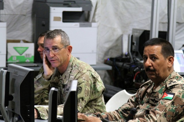 Maj. Gen. William Hickman, for U.S. Army Central deputy commanding general-operations, and Brig. Gen. Mekhled Suheim, Eager Lion 16 Combined Forces Land Component Command deputy commander, receive an operation and intelligence update brief during Eager Lion 16 at the Joint Training Center, Jordan, May 23, 2016. Eager Lion is an annual, bilateral exercise that took place taking place in the Hashemite Kingdom of Jordan between the Jordanian Armed Forces and the U.S. Military that is designed to strengthen relationships between the partner nations.  (U.S. Army photo by Staff Sgt. Jared Crain)