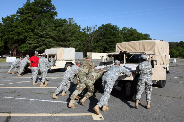 A HMMWV push was a two-part event that tested the Soldiers' strength. Three truck tires had to be loaded into the back of the vehicle while it was pushed down the course. This was a timed event that required both knowledge of the HMMWV's controls and physical strength.