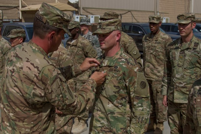 Col. James Bushong (left), USARCENT forward deputy chief of staff, awards Capt. David Dinklocker, a budget officer with USARCENT, with an Army Achievement Medal during an award ceremony at Camp Arifjan, Kuwait, May 21, 2016. Soldiers achieving the maximum score on the Army Physical Fitness Test earned the Army Physical Fitness Badge in addition to the medal, during the ceremony. (U.S. Army photo by Sgt. Youtoy Martin, USARCENT Public Affairs)