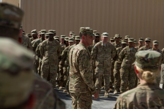 ol. James Bushong, USARCENT forward deputy chief of staff,  addresses Soldiers at an Army Fitness Badge award ceremony at Camp Arifjan, Kuwait, May 21, 2016. The badge is awarded to Soldiers who scored 270 or higher on the Army Physical Fitness Test. (U.S. Army photo by Sgt. Youtoy Martin, USARCENT Public Affairs)