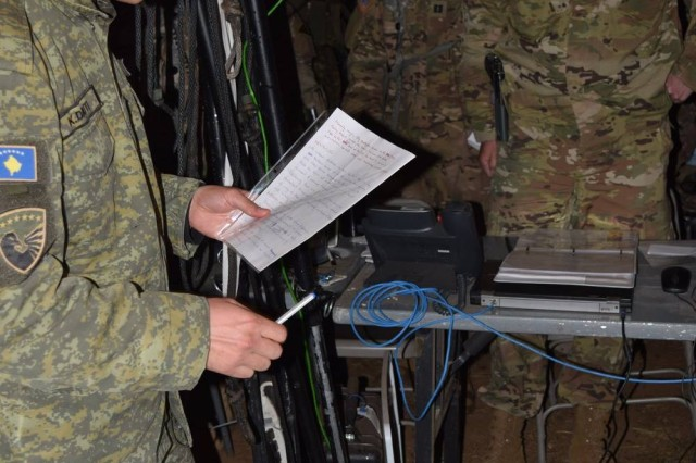 Capt. Korab Dauti, a Kosovo Security Force intelligence officer, briefs Lt. Col. Christopher Mahaffey, the commander for  5th Squadron, 7th Cavalry Regiment, the terrain and weather of mission analysis during Combined Resolve VI at Hohenfels, Germany, May 21. Eight Kosovar Soldiers were attached to the squadron during their decisive action rotation at the Joint Multinational Readiness Center, May 5-25.