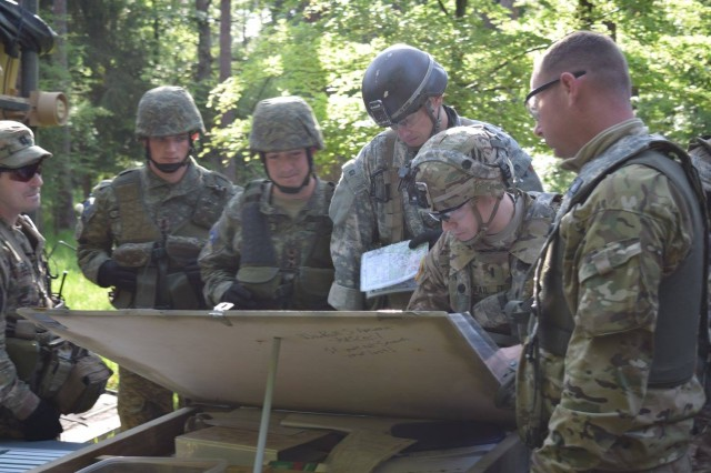 U.S. and Kosovar Soldiers go over the upcoming mission's scheme of maneuver during Combined Resolve VI at Hohenfels, Germany, May 21. Eight Kosovar Soldiers were attached to 5th Squadron, 7th Cavalry Regiment, during the squadron-level decisive action rotation at the Joint Multinational Readiness Center, May 5-25.