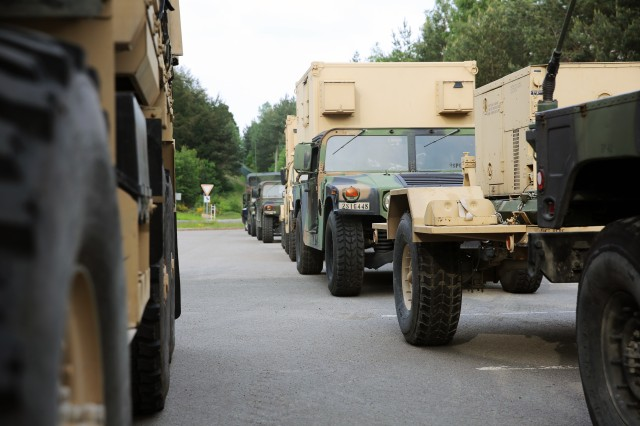 A convoy from Company B, 44th Expeditionary Signal Battalion, 2nd Signal Brigade, pauses May 25, 2016 at the Rhine Ordnance Barracks in Weilerbach, Germany during a 1,456 Kilometer (905 mile) convoy from Grafenwoehr to Bramcote, England to provide communications and network support to U.K. Allies in exercise Stoney Run.