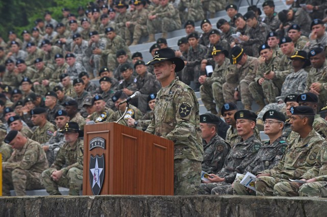 Brig. Gen. Brian Mennes, deputy commanding general for maneuver, 2nd Infantry Division, discusses the importance of the Expert Infantryman Badge and congratulates the U.S. and South Korean Soldiers that earned the badge, during a ceremony May 26 at the Schoonover Bowl, Camp Casey, South Korea. (U.S. Army photo by Staff Sgt. Keith Anderson, 1st Armored Brigade Combat Team Public Affairs, 1st Cav. Div.)