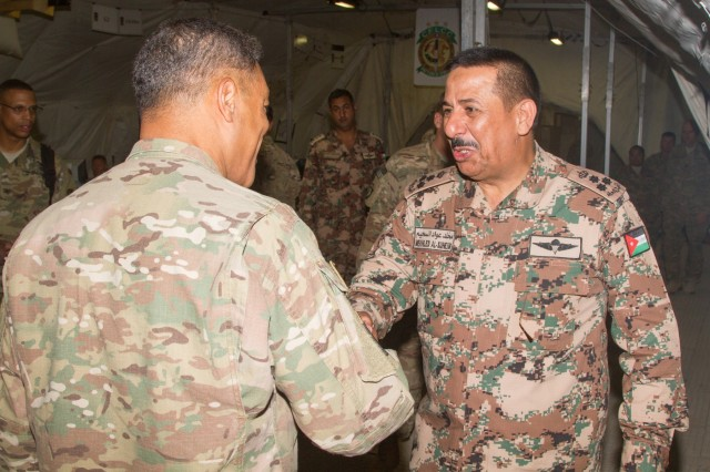 Jordan Army Brig. Gen. Mekhled Suheim, a military counselor at the Embassy of Jordan, greets Lt. Gen. Michael X. Garrett (left), U.S. Army Central commanding general, at the Contingency Command Post for Eager Lion 16 exercise at the Joint Training Center, Jordan, May 24, 2016. Eager Lion is an annual two-week interoperability exercise that aims to increase the partnership ties between the U.S. and Jordanian militaries. (U.S. Army photo by Sgt. David N. Beckstrom, 19th Public Affairs Detachment, U.S. Army Central)