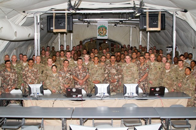 Lt. Gen. Michael X. Garrett, U.S. Army Central commanding general, and the staff of the Contingency Command Post for Eager Lion 16 gather for a group photo at the Joint Training Center, Jordan, May 24, 2016. Eager Lion is an annual two-week interoperability exercise that aims to increase the partnership ties between the U.S. and Jordanian militaries. (U.S. Army photo by Sgt. David N. Beckstrom, 19th Public Affairs Detachment, U.S. Army Central)