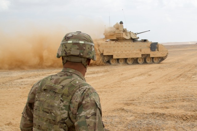 Lt. Gen. Michael X. Garrett, U.S. Army Central commanding general, watches a Bradley Fighting Vehicle maneuver on an objective during a combined arms live fire exercise at the Joint Training Center, Jordan, May 24, 2016. Eager Lion is an annual two-week interoperability exercise that aims to increase the partnership ties between the U.S. and Jordanian militaries. (U.S. Army photo by Sgt. David N. Beckstrom, 19th Public Affairs Detachment, U.S. Army Central)