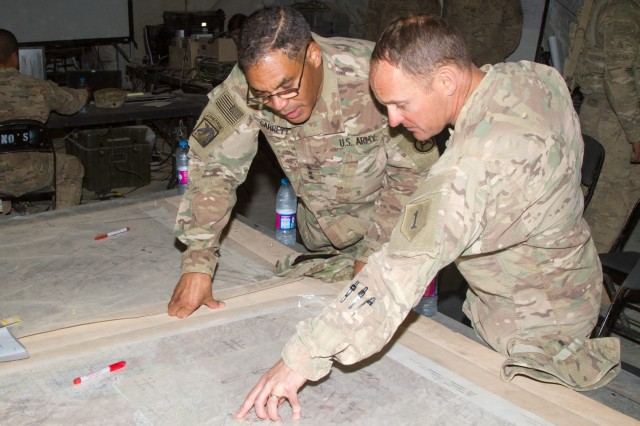 Col. Miles Brown, the commander of 2nd Armored Brigade Combat Team, 1st Infantry Division, explains the battle plan of the combined arms live fire exercise for Eager Lion 16 to Lt. Gen. Michael X. Garrett, U.S. Army Central commanding general, at the Joint Training Center, Jordan, May 24, 2016. Eager Lion is an annual two-week interoperability exercise that aims to increase the partnership ties between the U.S. and Jordanian militaries. (U.S. Army photo by Sgt. David N. Beckstrom, 19th Public Affairs Detachment, U.S. Army Central)