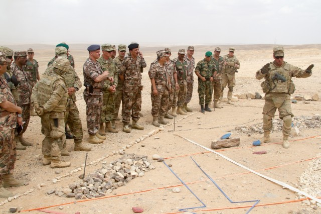 U.S. Army Maj. Steven Veves, the operations officer for 2nd Armored Brigade Combat Team, 1st Infantry Division, briefs the concept of the operation to Lt. Gen. Michael X. Garrett, U.S. Army Central commanding general, and Prince Faisel Bin Hussein, the deputy supreme commander of the Jordan Armed Forces, and others prior to the combined arms live fire exercise for Eager Lion 16 at the Joint Training Center, Jordan, May 24, 2016. (U.S. Army photo by Sgt. David N. Beckstrom, 19th Public Affairs Detachment, U.S. Army Central)