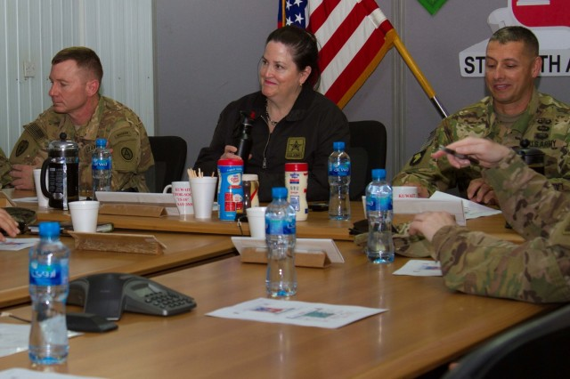 The Honorable Katherine Hammack, the assistant secretary of the Army for installations, energy and environment, Brig. General John S. Laskodi, with the Department of the Army Headquarters logistics office and Col. Jeff Stewart, commander of Area Support Group-Kuwait, prepare for a briefing in a conference room at the Kuwait Naval Base, Kuwait, May, 24, 2016. The delegation received a brief on partnership opportunities with Kuwaiti military and installation operations before visiting sites on the base. (U.S. Army photo by Sgt. Youtoy Martin, U.S. Army Central Public Affairs)