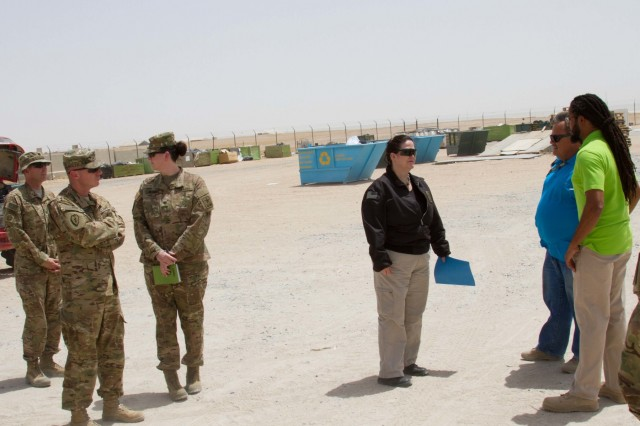 The Honorable Katherine Hammack, the assistant secretary of the Army for installations, energy and environment, listens to Reginald Coleman and Thomas Frank, with the Environment Recycling Center at Camp Buehring, Kuwait, May, 24, 2016. The ERC facilitates the recycling of plastic, paper and metal products. (U.S. Army photo by Sgt. Youtoy Martin, U.S. Army Central Public Affairs)