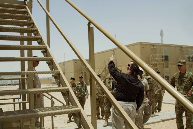 The Honorable Katherine Hammack, the assistant secretary of the Army for installations, energy and environment, takes a look at newly built modular energy efficient structures on Camp Buehring, Kuwait, May, 24, 2016. Construction on the units are about 85 percent completed and some units are equipped with solar roof panels, providing self-sustaining energy. (U.S. Army photo by Sgt. Youtoy Martin, U.S. Army Central Public Affairs)