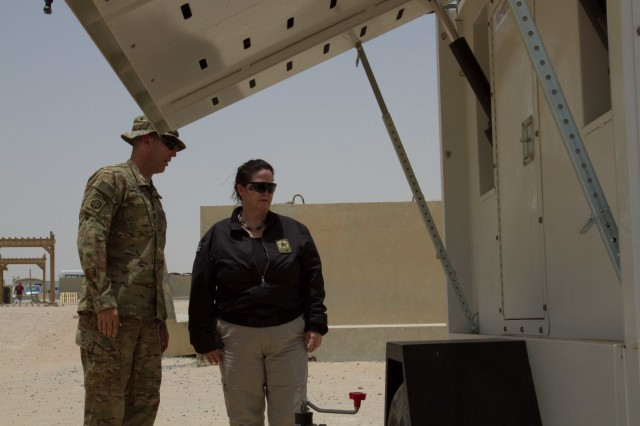 Lt. Col. Lee Johnson, the Camp Buehring base commander, briefs the Honorable Katherine Hammack, the assistant secretary of the Army for installations, energy and environment, on the solar powered light system project at bases throughout the U.S. Army Central area of responsibility May, 24, 2016. USARCENT plans to replace diesel powered light systems with the more energy efficient solar-powered systems. (U.S. Army photo by Sgt. Youtoy Martin, U.S. Army Central Public Affairs)