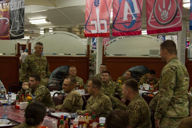 Lt. Gen. Robert L. Caslen Jr., the superintendent of the United States Military Academy at West Point, speaks with 2nd Lt. Daniel Engstrom, an intelligence officer, with 2nd Battalion, 70th Armored Regiment, 2nd Armored Brigade Combat Team, 1st Infantry Division and other graduates of West Point during dinner at Camp Buehring, Kuwait, May 28, 2016. Caslen and members of the school's athletic department visited with graduates from West Point to get feedback from their time at the academy and how it affects the work they now do in the Army. (U.S. Army photo by Sgt. Youtoy Martin, USARCENT Public Affairs)