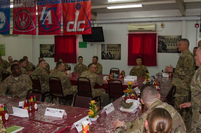 Lt. Gen. Robert L. Caslen Jr., the superintendent of the United States Military Academy at West Point, speaks to graduates of West Point during lunch on Camp Arifjan, Kuwait, May 28, 2016. Caslen and members of the school's athletic department visited with graduates from West Point to get feedback from their time at the academy and how it affects the work they now do in the Army. (U.S. Army photo by Sgt. Youtoy Martin, USARCENT Public Affairs)