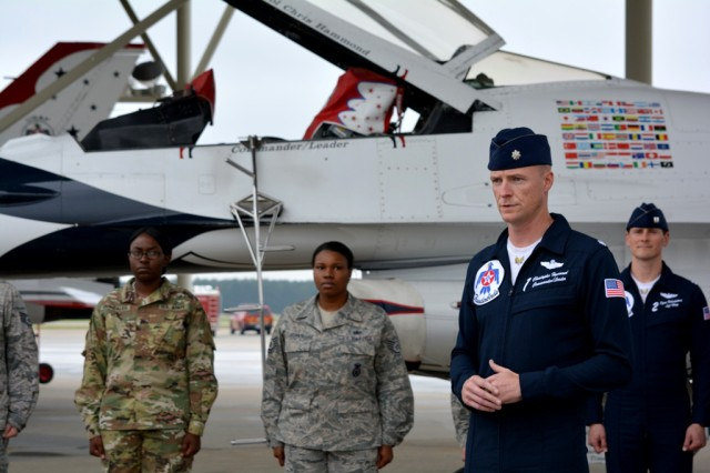 Lt. Col. Christopher Hammond, commander of the U.S. Air Force Thunderbirds, addresses attendees at a reenlistment ceremony during the Shaw Air Expo & Open house May 20, 2016 at Shaw Air Force Base, S.C. U.S. Army Soldier Sgt. Quenisha Gonzales reenlisted to serve an additional four years as a unit supply specialist.