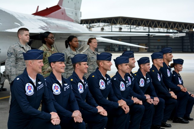 Sgt. Quenisha Gonzales (second from left), poses for a photo with airmen who reenlisted and members of the Thunderbirds, the U.S. Airforce precision-flying demonstration team, during a reenlistment ceremony May 20, 2016 at Shaw Air Force Base, S.C. The troops had the unique opportunity to reenlist during the Shaw Air Expo & Open House.