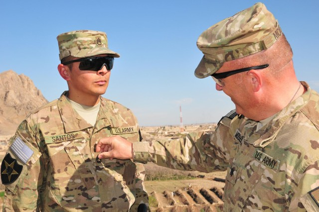 Staff Sgt. Luis Santos is promoted to sergeant first class, March 1, 2013, by Lt. Col. Bruce Moses, at Forward Operating Base Masum Ghar in the Panjwa'i district of Afghanistan.