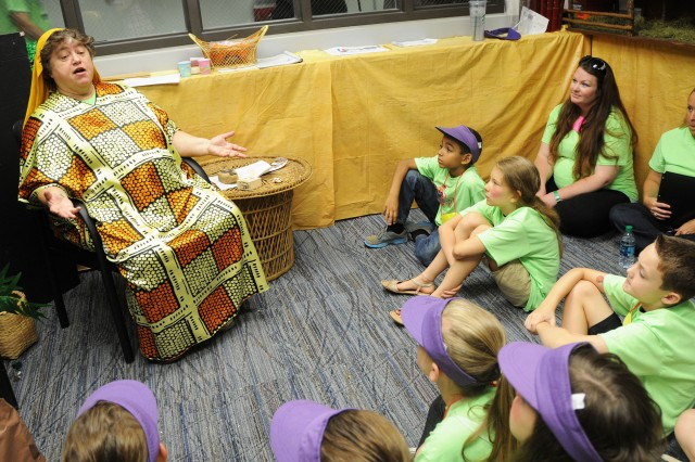 Nancy Jankoski, Fort Rucker Religious Support Office director of religious education, tells a story to children during last year's Vacation Bible School.