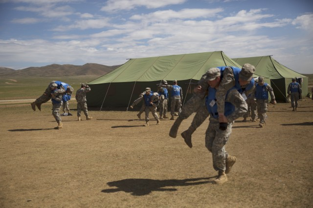 U.S. Soldiers with the Alaska Army National Guard practice patient transportation techniques during the combat medical care training lane of Khaan Quest 2016 at Five Hills Training Area near Ulaanbaatar, Mongolia, May 30. The training equipped soldiers with essential life-saving skills and the ability to prioritize injuries and medical care.