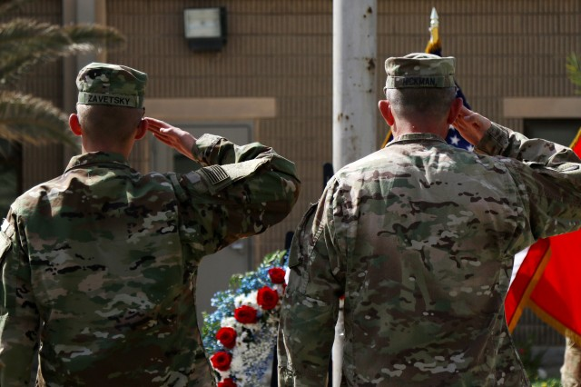 Maj. Gen. William Hickman, the deputy commanding general -- operations for U.S. Army Central and Pvt. Zachary Zavetsky, an USARCENT soldier from Leland, NC, salute during the Memorial Day Service hosted by USARCENT and the Area Support Group -- Kuwait on May 30, 2016 at Camp Arifjan, Kuwait. The Memorial Day service honors fallen Servicemembers. (Photo by Spc. Angela Lorden/Released)