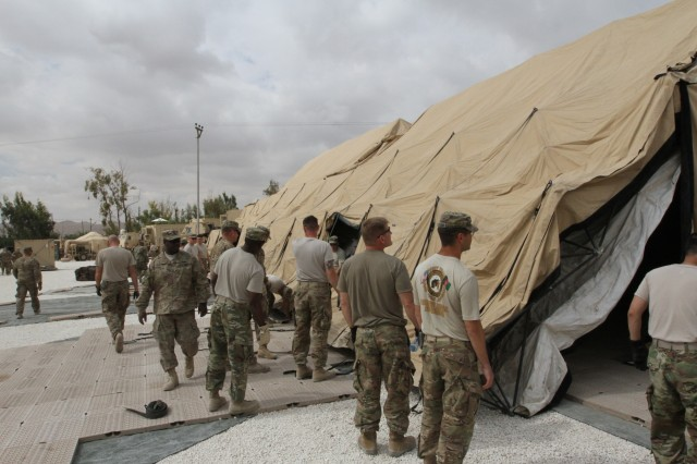 Soldiers assigned to U.S. Army Central erect the deployable rapid assembly shelter, also known as DRASH, before the annual exercise called Eager Lion. Eager Lion is a multinational exercise held between the U.S. Army and Jordanian Armed Forces where relationships are deployed and interoperability is practiced. (U.S. Army photo by Sgt. Victor Everhart Jr.)