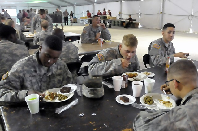 Soldiers from the 2nd Brigade Combat Team, 3rd Infantry Division, Fort Stewart, Georgia, enjoy supper in a field tent upon completion of their rotational training at Fort Polk. LRC-Polk provides food program management in support of the Joint Readiness Training Center there. (Photo by Jon Micheal Connor, ASC Public Affairs)