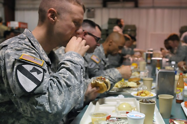 Soldiers from the 2nd Brigade Combat Team, 3rd Infantry Division, Fort Stewart, Georgia, enjoy an evening meal upon completion of their rotational training at Fort Polk. (Photo by Jon Micheal Connor, ASC Public Affairs)