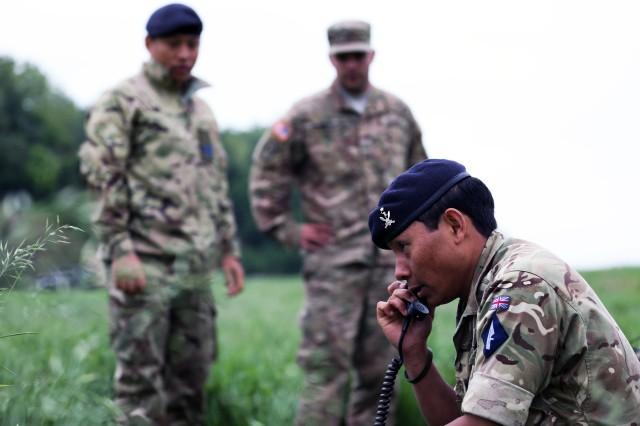 A Soldier from the British Army's 250th Gurkha Signal Squadron, 30th Signal Regiment, talks on an HF radio at a cross training event with U.S. Army Soldiers from the 44th Expeditionary Signal Battalion, 2nd Signal Brigade, June 1, 2016 during exercise Stoney Run in Bramcote, England. Stoney Run is an annual U.S.-U.K. signal exercise designed to test and validate communications and network capabilities, and enhance interoperability and partner capacity between the two NATO Allies.