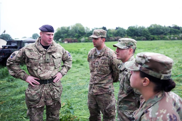 Maj. John Walton, commander of the British Army's 250th Gurkha Signal Squadron, 30th Signal Regiment, speaks with U.S. Army Soldiers from the 44th Expeditionary Signal Battalion, 2nd Signal Brigade, at a cross training event, June 1, 2016 during exercise Stoney Run in Bramcote, England. Stoney Run is an annual U.S.-U.K. signal exercise designed to test and validate communications and network capabilities, and enhance interoperability and partner capacity between the two NATO Allies.