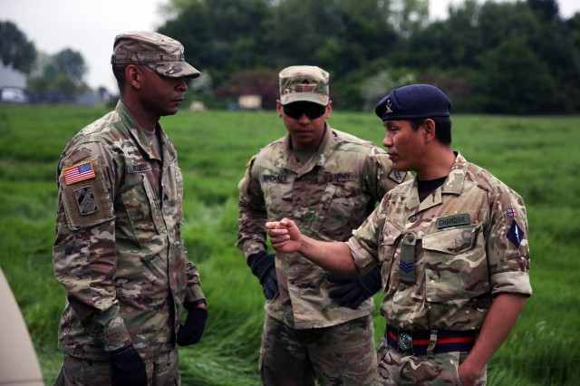 A Soldier from the British Army's 250th Gurkha Signal Squadron, 30th Signal Regiment, speaks to U.S. Army Soldiers from the 44th Expeditionary Signal Battalion, 2nd Signal Brigade, at a cross training event, June 1, 2016 during exercise Stoney Run in Bramcote, England. Stoney Run is an annual U.S.-U.K. signal exercise designed to test and validate communications and network capabilities, and enhance interoperability and partner capacity between the two NATO Allies.