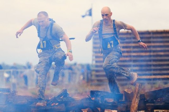 Staff Sgt. Erich Friedlein and Capt. Robert Killian jump over the fire pit during the Spartan Race that was actually an event during the Best Ranger Competition in April 2016.  It was the first time there was a Spartan Race as an event.