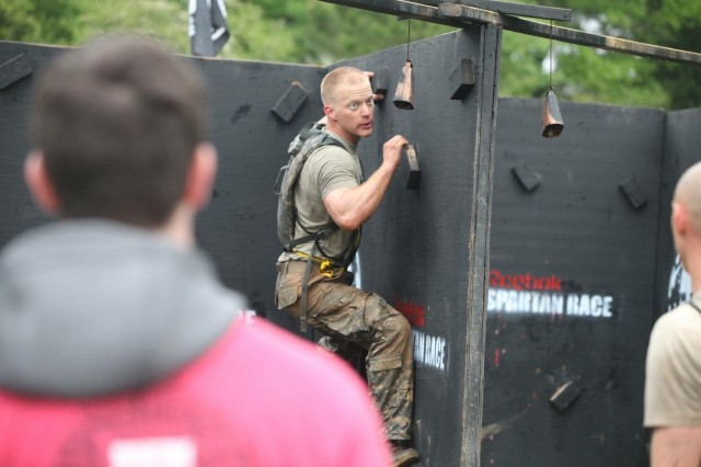 Staff Sgt. Erich Friedlein negotiates the Z wall, one of the 26 obstacles during the Spartan Race portion of the Best Ranger Competition at Fort Benning, Ga., in April 2016.