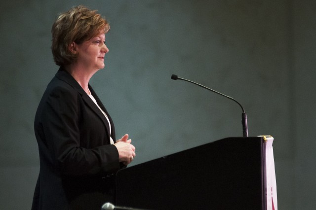 Lisha Adams, executive deputy to the commanding general, U.S. Army Materiel Command, provides opening remarks at the ninth annual Midwest Small Business Government Contracting Symposium at the iWireless Center, Moline, Illinois, May 25. (Photo by Kevin Fleming, ASC Public Affairs)