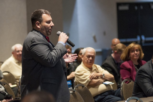 An audience member asks a question during the ninth annual Midwest Small Business Government Contracting Symposium at the iWireless Center, Moline, Illinois, May 26. (Photo by Kevin Fleming, ASC Public Affairs)