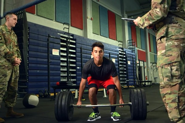 "Soldiers administer the ""strength deadlift"" portion of the Occupational Physical Assessment Test to potential recruits during an OPAT pilot program."