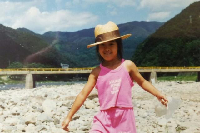 Yeeun Youn at a stream in South Korea catching fish as a young girl.