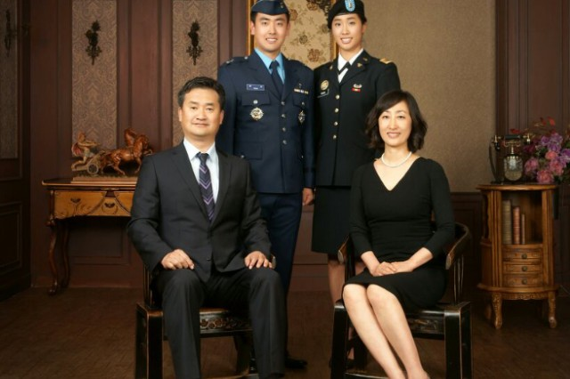 Family photo of Yeeun Youn with her parents in the front and her brother standing next to her when he was in the South Korean Air Force.