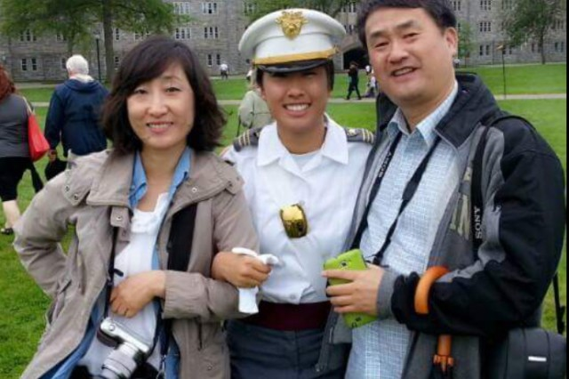 Yeeun Youn and her parents at West Point during her last parade as a cadet.