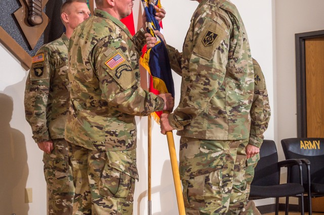 From left, Brig. Gen. James Bonner, accepts the Chemical Regimental colors from Maj. Gen. Kent Savre, Maneuver Support Center of Excellence and Fort Leonard Wood commanding general, during the U.S. Army CBRN School's change-of-commandancy May 26 in Lincoln Hall. Bonner assumed responsibility as the 29th Chief of Chemical.
