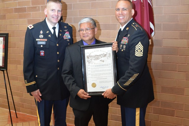 Brooke Army Medical Center Commander Col. Jeffrey Johnson and Command Sgt. Maj. Albert Crews present Retired Air Force Col. Nonie Cabana a token of appreciation May 24, 2016 for speaking at the Brooke Army Medical Center Asian American Pacific Islander Heritage Month celebration.