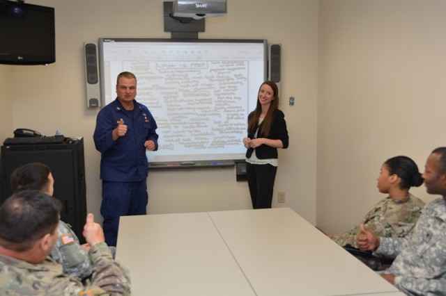 U.S. Public Health Service Capt. Richard Schobitz and Melissa Ramirez conduct a planning meeting for the next session of Brooke Army Medical Center's Intensive Outpatient Program for Post-traumatic Stress Disorder, June 2, 2016.