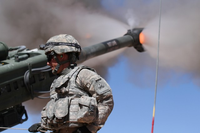 Pvt. Max Cardoso, artilleryman, 2nd Battalion, 3rd Field Artillery Regiment, 1st Brigade Combat Team, 1st Armored Division, fires a M777 Howitzer during Hustler Trough III May 23 at the Orogrande Range Complex, N.M.