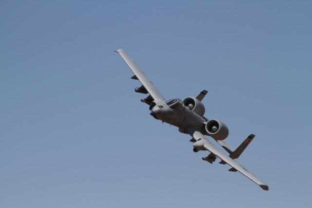 An Air Force A-10 Thunderbolt II piloted by an Airman assigned to 66th Weapons Squadron, Nellis Air Force Base, Nevada, executes a fly-by after engaging targets during the Hustler Trough III, May 23, at the Orogrande Range Complex, NM.